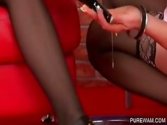 Lesbo on heels gets wet and messy leggs