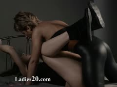 Two girls in latex loving with strap on