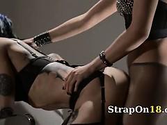Tatto lezzies enjoying sex with strap on