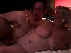 Busty fat grandma enjoys sex with a boy