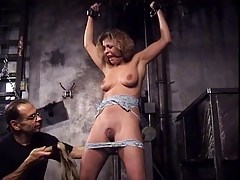 Bound and gagged slut with nice naturals teased